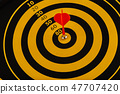 The game of darts, darts on the target. 47707420