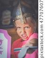 Girl dressed as a fiercy knight 47707607