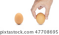 Hand choosing good quality egg, isolated on white 47708695
