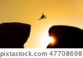 Silhouette a man jumping over precipice 47708698