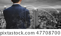 Double exposure businessman and cityscape 47708700