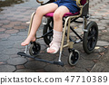 Leg broken boy sit on wheelchair 47710389