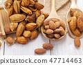 Almonds in a black bowl against dark 47714463
