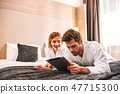 Ordering online service. Young man using tablet in hotel 47715300