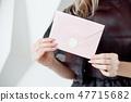 letter,hand,holding 47715682