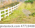 white fence and field 47719488