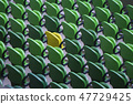 Seating rows in a stadium with weathered chairs 47729425