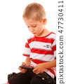 Little boy playing games on smartphone 47730411