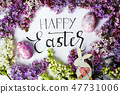 Easter card with spring flowers and painted eggs 47731006