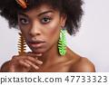 Portrait of pretty ethnic lady with odd earrings 47733323