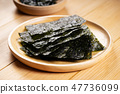 Crispy dried seaweed on wooden dish 47736099