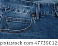 Front view blue jeans background 47739012