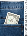 One dollar bill in the back pocket of blue jeans 47739061