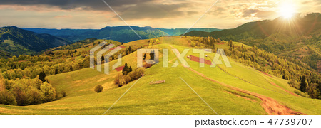panorama of a countryside in mountains at sunset 47739707