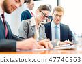Businesspeople analyzing documents or reading a contract 47740563