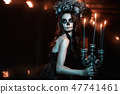 Woman with makeup for Halloween. 47741461