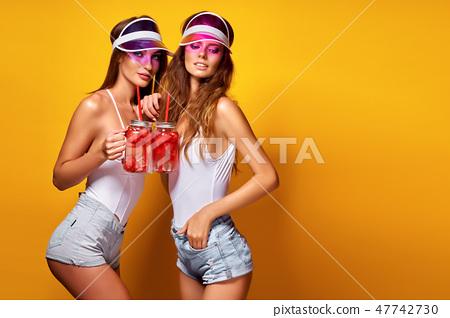 Stylish ladies with drinks 47742730