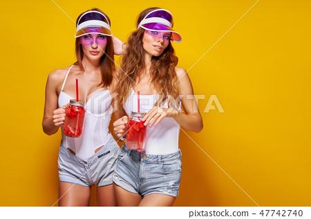 Stylish ladies with drinks 47742740