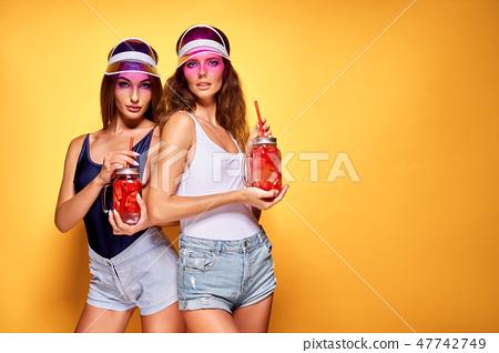Stylish ladies with drinks 47742749