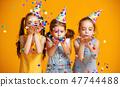 happy birthday children girls confetti on yellow 47744488