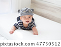 Asian baby boy smiling and relaxing  bedrom 47750512