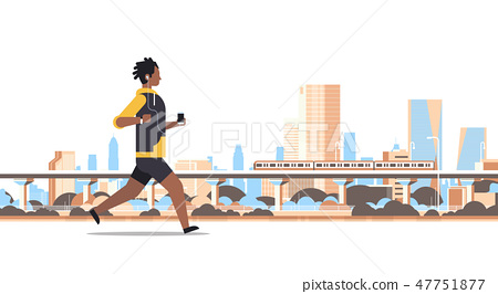 fitness man running outdoor african guy listening to music with headphones on smartphone healthy 47751877