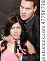 Scene of violence with firearm between men and women. 47756738