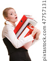 Business woman holding stack of folders documents 47757131