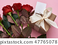 Perfect celebration. Close up view of gift box in kraft wrapping paper and fresh red roses 47765078