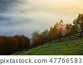 rural area in mountains at foggy sunrise 47766583