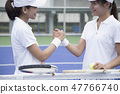 Two women tennis players shaking hands 47766740