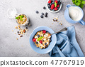 Oat granola with berries and yoghurt 47767919