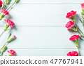 Bouquet of pink carnation on light turquoise wooden background 47767941