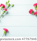 Bouquet of pink carnation on light turquoise wooden background 47767946