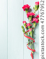 Bouquet of pink carnation on light turquoise wooden background 47767952