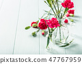 Bouquet of pink carnation on light turquoise wooden background 47767959