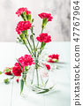 Bouquet of pink carnation on light turquoise wooden background 47767964
