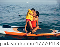 Mother with daughter on a paddle board 47770418