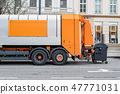 Garbage disposal lorry at city street. Waste dump truck on town road. Municipal and urban services 47771031