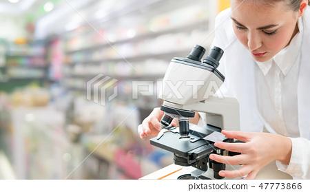 Scientist researcher uses microscope in laboratory 47773866
