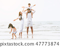 Happy family goes vacation on the beach in summer. 47773874