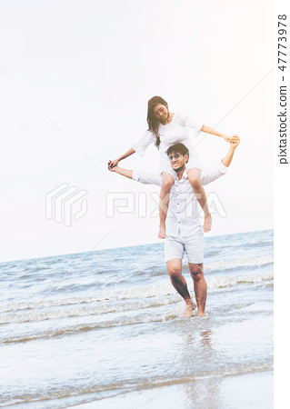Couple going honeymoon on tropical beach in summer 47773978