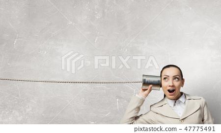 Woman using deaf phone 47775491