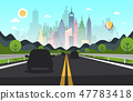 Road with Cars Silhouettes and City on Backgroud 47783418