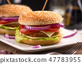 Hamburger with double cheese, red onions and tomat 47783955