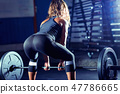 Woman weightlifting on training 47786665