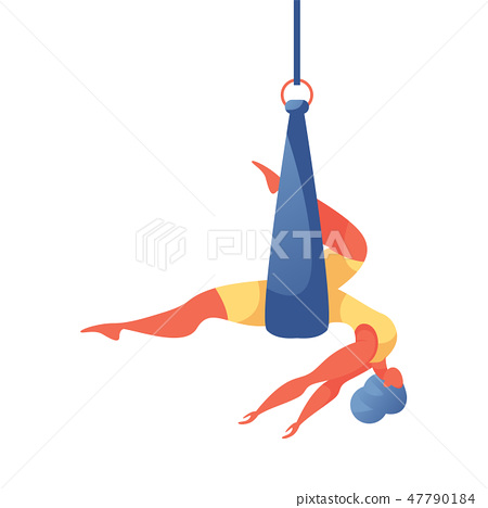 woman doing aerial silk yoga in hammock or ribbon 47790184