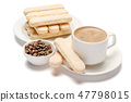 White ceramic cup of coffee with a savoiardi ladyfinger cookie on a plate 47798015