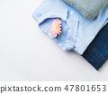 Folded female clothes on white. Fashion flat lay 47801653