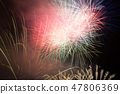 Colorful fireworks on night sky 47806369